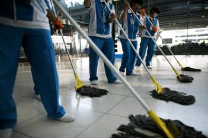 BANGKOK, THAILAND - DECEMBER 03:  Thai workers clean the floor at Suvarnabhumi International Airport after the end of the seige on December 3, 2008 in Bangkok, Thailand. Yesterday, a court dissolved Thailand's top three ruling parties for electoral fraud, banned the prime minister from politics for five years and thus brought down a government that has faced months of protests. Deputy Prime Minister Chaowarat Chanveerakul will become the caretaker prime minister. The on-going political crisis during the holiday season stranded 300,000 foreign tourists, paralysing Thailand's lucrative tourist industry.  (Photo by Chumsak Kanoknan/Getty Images)
